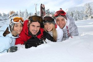 friends-lying-in-snow-smiling